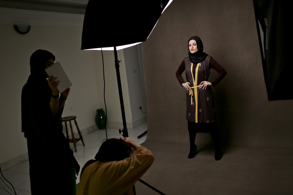 Iranian Sahar, is posing for a fashion photographer.modelling these days very popular between iranian youth