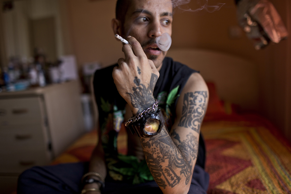 Siavash, a tattooist, smokes a cigarette. While not illegal, Islamic law is often used to denouce those sporting them.